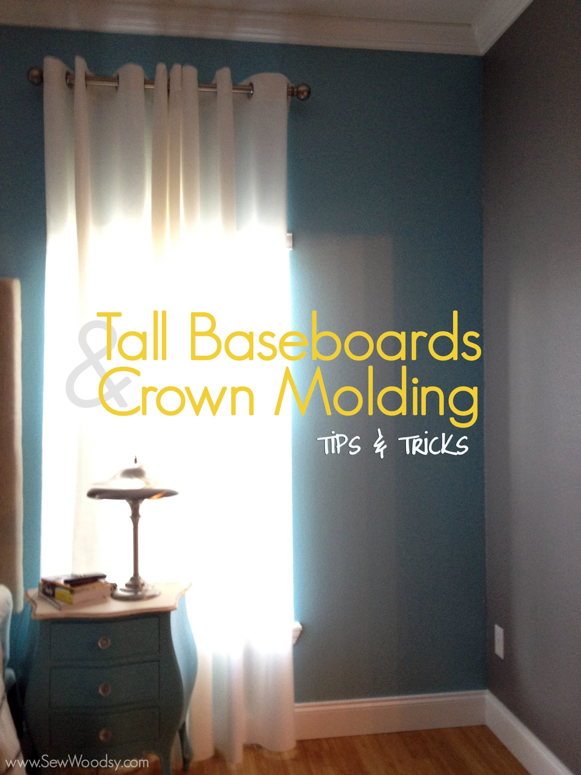 tall baseboards & crown molding