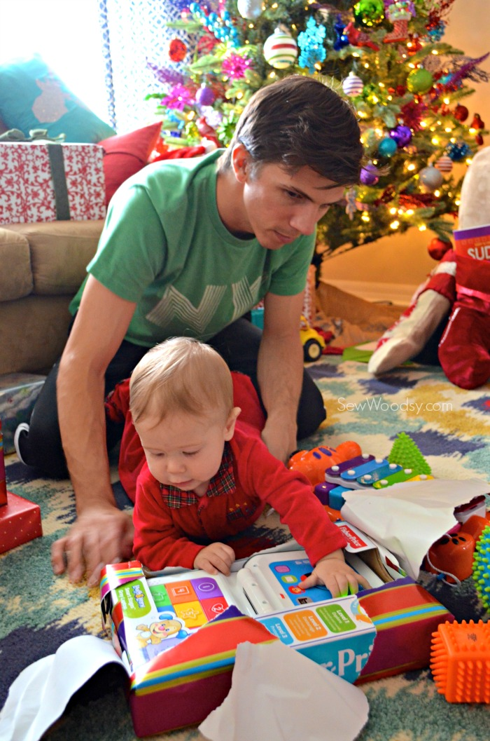 baby and dad opening gift