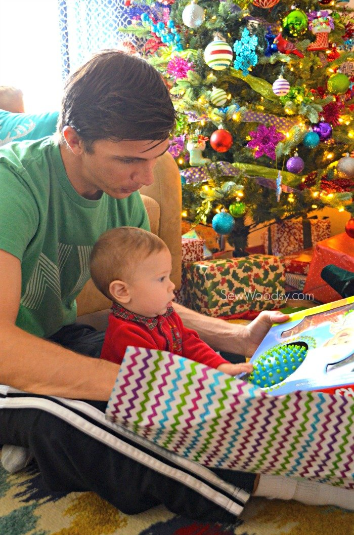baby opening up christmas gift